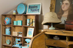Collection of vintage cans in shades of blue on wooden shelves