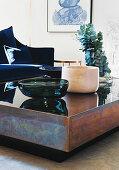Bowls on chunky metal and glass coffee table