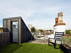 Artificial lawn on roof terrace with city view