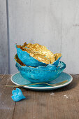 Handmade papier-mâché bowls decorated in blue and gold