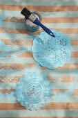 Doilies painted blue
