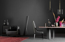 Black armchair, chair and table in front of black wall