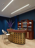 Curved gilt bar and drinks cabinet against blue wall
