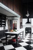 Renovated kitchen in black and white with glossy ceramic floor tiles