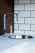 Ceramic worksurface with stainless steel sink and designer tap fitting