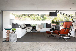 Designer armchair and panoramic window in modern living room