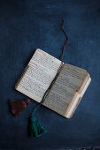 Open vintage notebook with hand-made tassels as bookmarks