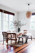 Wooden table with classic chairs and rustic bench in the dining area