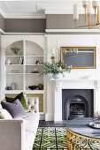Renovated living room with fireplace, white shelf and upholstered sofa