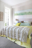Fringed blanket on bed in bright bedroom