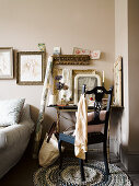Antique chair at desk with vintage-style ornaments and sections of gilt frames