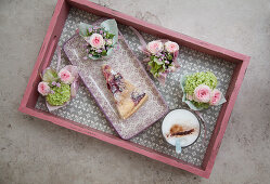 Small posies and cake on tray
