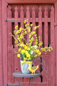 Spring bouquet of forsythia, ranunculus, cream narcissus, tulips, birch twigs and narcissus