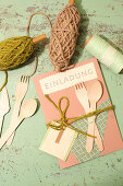 Handmade invitation card with wooden cutlery