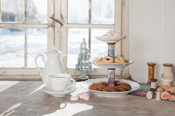 Biscuits on cake stand made from plates and old yarn reels