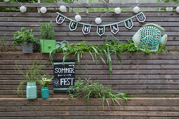 Bunting and sign handmade from chalkboard fabric in garden