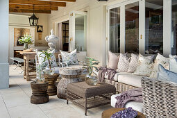 Outdoor seating area on roofed terrace with tiled floor