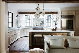 Open kitchen with island and antique chandeliers