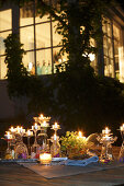 Arrangement of stemware and tealights
