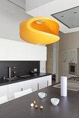 Modern orange designer lamp in kitchen
