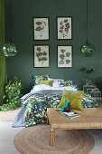 Green bedroom with repeated leaf motif