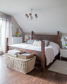 DIY wooden bed, bedside cabinets and wicker trunk in bedroom