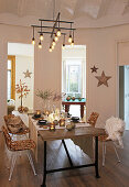 Festively set table in connecting room with vaulted ceiling