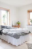 Romantic bed with valance in simple bedroom
