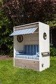 DIY wooden beach chair with blue-striped cushions