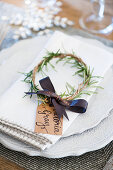 Handmade circlet of rosemary decorating place setting