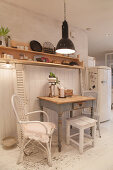 Shabby-chic dining area against white board wall