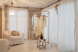 Clothes rack in white bedroom