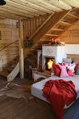 Cosy couch with cushions next to wood-burning stove