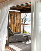 Lounger on balcony with sea view