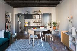 Living-dining room with open doorway leading into bedroom