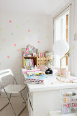 Polka-dots on wall behind desk below window
