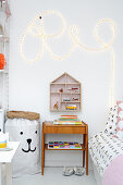 Word written with rope light and vintage furniture in child's bedroom