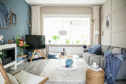 Scandinavian-style living room with blue and beige walls