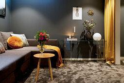 Dark living room in shades of grey and ochre