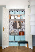 DIY fitted cupboard with open double doors