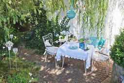 Romantic seating area with crocheted accessories