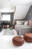 Cosy, Bohemian-style attic room with grey walls