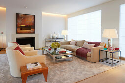 Pale sofa set and fireplace in elegant living room