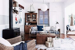 Wicker seating, chest as a coffee table with Christmas decorations and wrapped presents in the living room