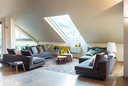 Sofa in set in elegant attic living room