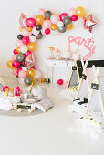 DIY balloon garland and wigwams in party room