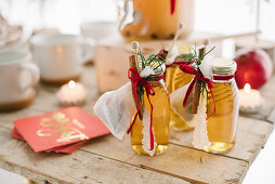Bottles of apple juice as guest favours