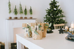 Festive brown gift bags on white table
