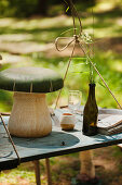 Mushroom ornament on suspended table outdoors