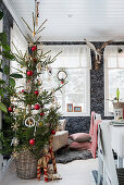 Christmas tree in dining area with black patterned wallpaper